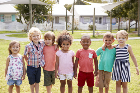 Portrait Of Pupils At Montessori School During Outdoor Break
