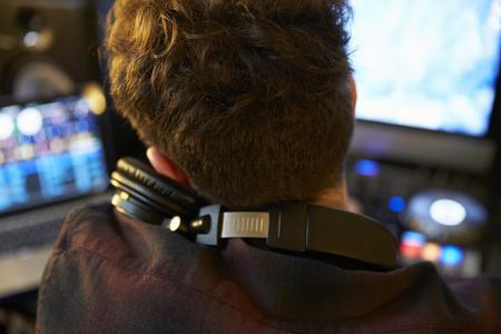 Young Man Mixing Music using Headphones Stok Fotoğraf