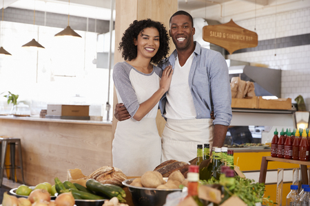 Portrait Of Couple Running Organic Food Store Together Stock Photo