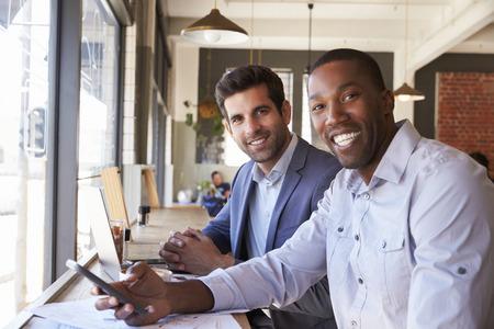 window view: Portrait Of Businessmen Meeting In Coffee Shop Stock Photo