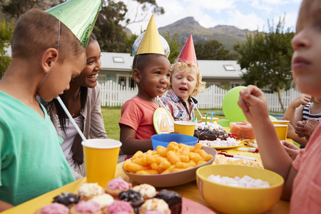 3 4 years: Mother With Children Enjoying Outdoor Birthday Party Together