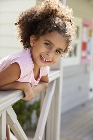 Portrait Of Female Pupil Outside Classroom At Montessori School