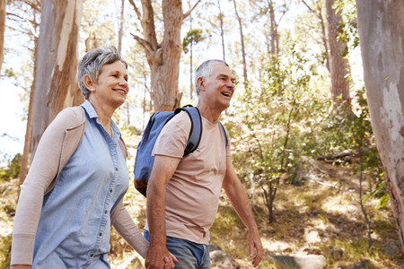 Mature Couple Hiking Along Forest Path Together Stock fotó