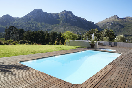 Outdoor Swimming Pool Surrounded With Wooden Decking