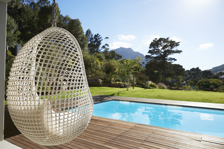 Suspended Seat Next To Decking Around Outdoor Swimming Pool Stock fotó