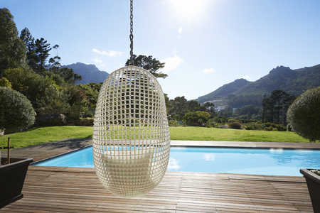 Suspended Seat Next To Decking Around Outdoor Swimming Pool Banco de Imagens