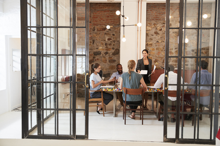 Creative business team in discussion in a meeting room