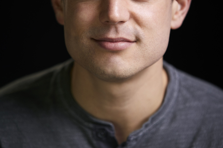Cropped portrait of a smiling young white man