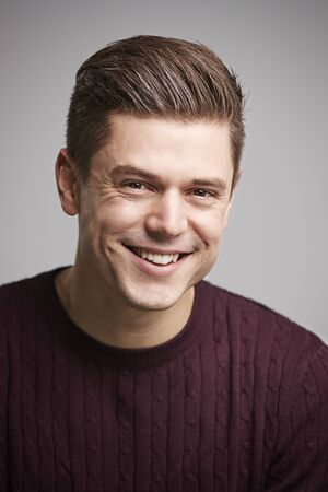 Portrait of a smiling young white man looking to camera