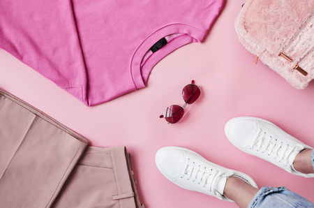 Flat Lay Shot Of Female Pastel Pink Clothing With Feet