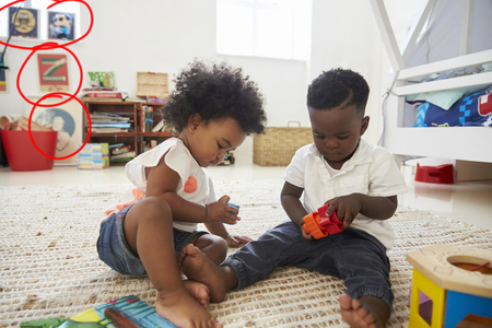 Baby Boy And Girl Playing With Toys In Playroom Together 版權商用圖片