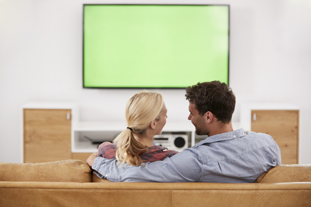 Rear View Of Couple Watching Television Together Banque d'images