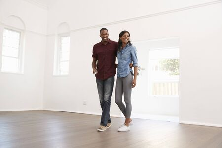 Excited Young Couple Moving Into New Home Together