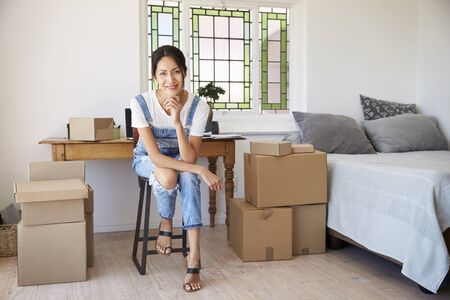 Portrait Of Woman In Bedroom Running Business From Home