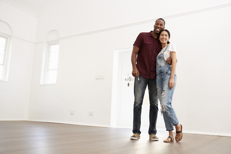 Excited Young Couple Moving Into New Home Together Banco de Imagens - 86206732