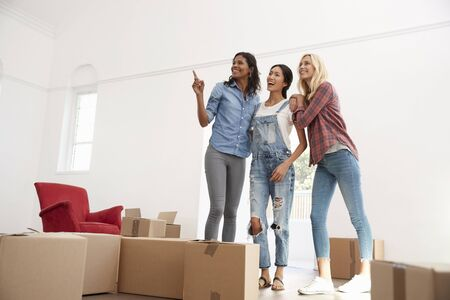Three Female Friends Moving Into New Home Together