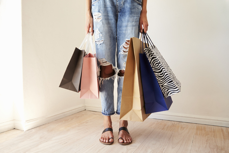 Close Up Of Woman Standing At Home Holding Shopping Bags Reklamní fotografie
