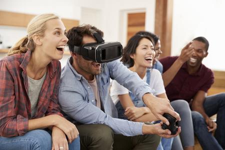 Friends Playing Computer Game With Virtual Reality Headset Reklamní fotografie