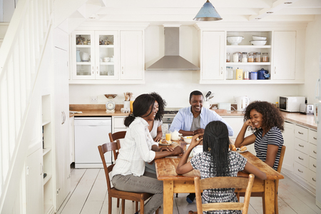 Family With Teenage Children Eating Breakfast In Kitchen Stock Photo - 88062141