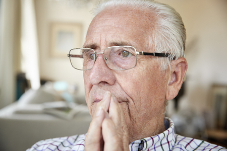Close up of contemplative senior man at home