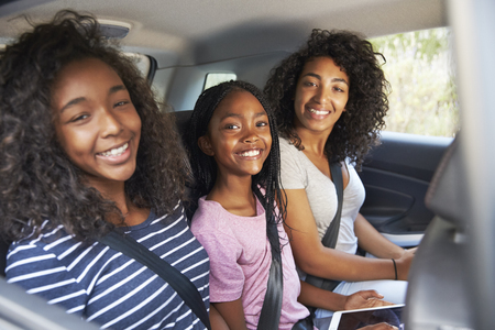 Portrait Of Family With Teenage Children In Car On Road Trip Stock fotó