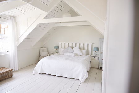 Interior View Of Beautiful Light And Airy White Bedroom Banco de Imagens - 88062620