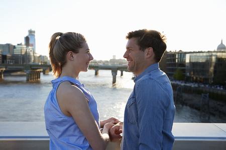 Romantic Couple Standing On Bridge Over River Thames In London Reklamní fotografie - 88113878