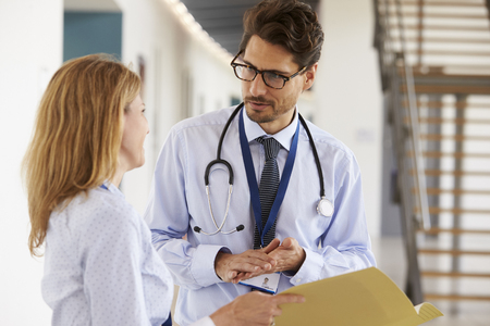Young male and female doctors consulting each other Stock Photo