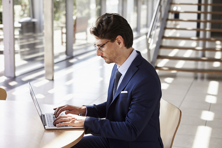 Young professional man using laptop, elevated view