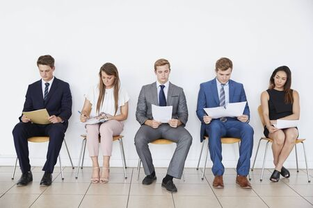 Candidates waiting for job interviews, full length, front Stock fotó - 89639753