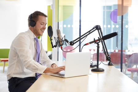 Happy young man recording a podcast, close up Stock Photo