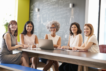 Female work colleagues at informal meeting looking to camera Stock Photo - 89290359