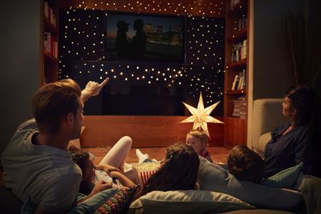 Family Enjoying Movie Night At Home Together Archivio Fotografico