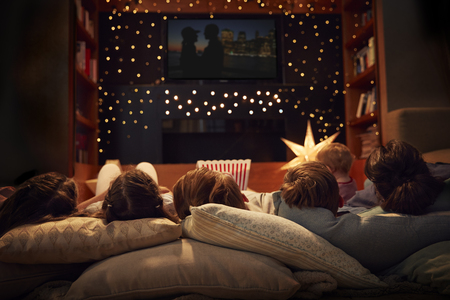 Family Enjoying Movie Night At Home Together 스톡 콘텐츠