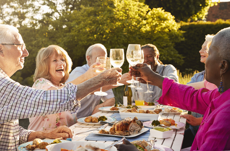 Group Of Senior Friends Making A Toast At Outdoor Dinner Party Stock fotó