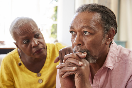 Senior Woman Comforting Man With Depression At Home