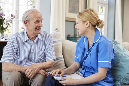 Female Community Nurse Visits Senior Man At Home