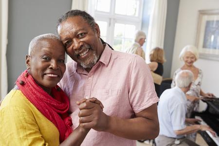 Portrait Of Senior Couple Enjoying Dancing Club Together Stock fotó