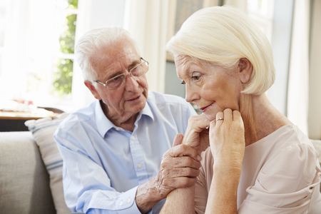 Senior Man Comforting Woman With Depression At Home Stockfoto