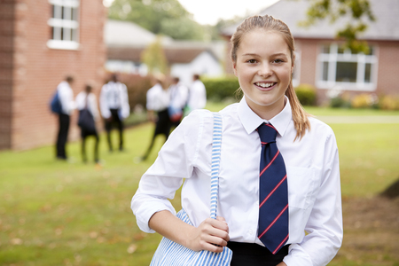 Portrait Of Female Teenage Student In Uniform Outside Buildings Reklamní fotografie - 91536299