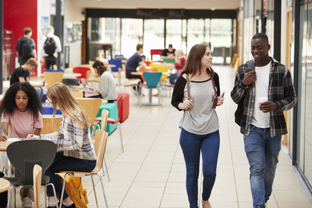 Communal Area Of Busy College Campus With Students Stock Photo