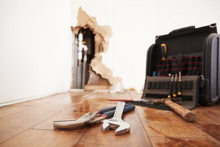 Tools and toolbox lying on flood damaged floor Stockfoto