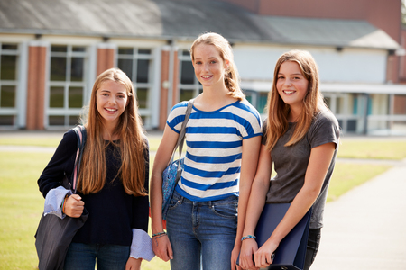 Group Of Female Teenage Students Walking Around College Campus