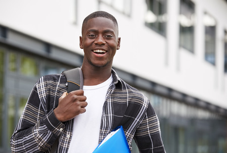 Portrait Of Male Student Standing Outside College Building Reklamní fotografie - 91652691