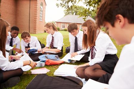 Teenage Students In Uniform Working On Project Outdoors Reklamní fotografie
