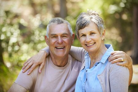Portrait Of Loving Mature Couple In Countryside Together