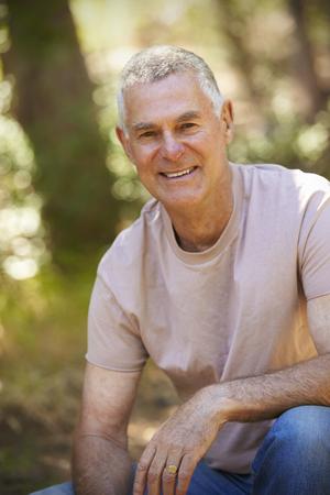 Outdoor Portrait Of Mature Man In Woodland