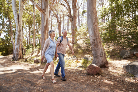 Mature Couple Hiking Along Forest Path Together Reklamní fotografie