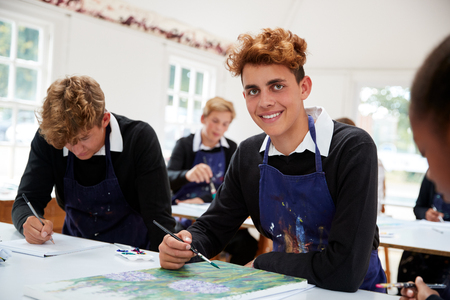Portrait Of Teenage Students Studying Together In Art Class