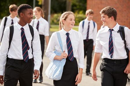 Group Of Teenage Students In Uniform Outside School Buildings Stockfoto
